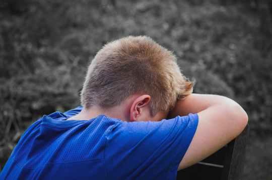 boy_facing away_sad